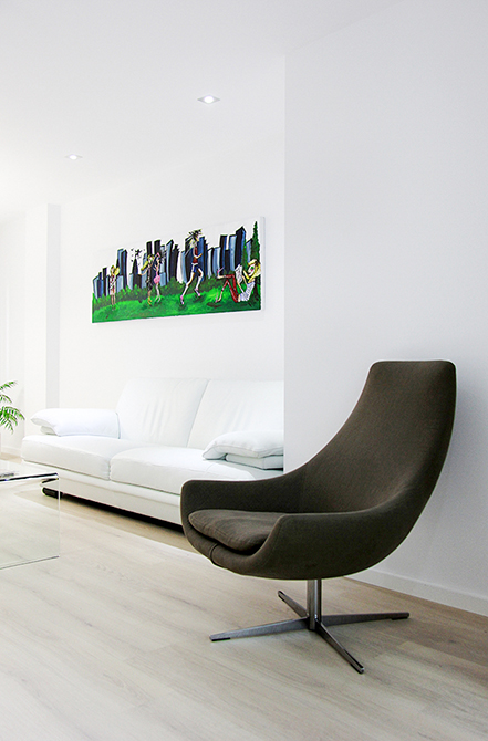 Sillón moderno en la reforma integral de un pequeño piso |Chiralt arquitectos Valencia | Centelles